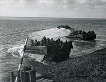 British Marine commandos cross Scheldt River aboard Buffaloes