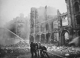 Firefighters put out a blaze after a 1941 London air raid