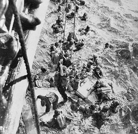 HMS Dorsetshire plucking Bismarck survivors from the Atlantic, May 1941