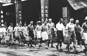 Fall of Hong Kong: Western bankers escorted to Hong Kong detention center, December 1941