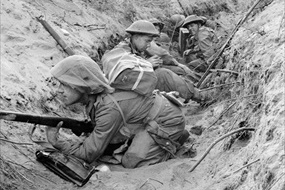 British soldiers shelter in captured trench, Cisterna, May 1944