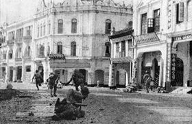 Japanese troops advance through Kuala Lumpur, Malaya, January 1942