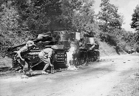 British soldiers pass a burning German IV tank in Salerno area