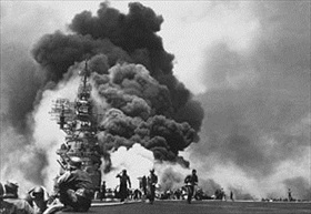 "Aircraft carrier USS ""Bunker Hill"" billowing fire from deck, May 11, 1945"