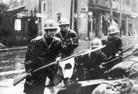 Japanese marines with fixed bayonets on Shanghai street, 1937