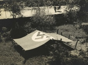 German flag protects shelter from Japanese aircraft attack, 1937