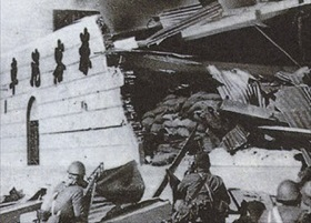 Japanese soldiers sift through Shanghai ruins