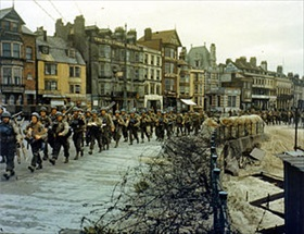 U.S. troops march to English embarkation docks