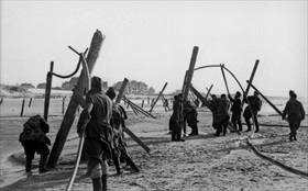 German Atlantic Wall defenses: Planting high wooden poles on French beaches, 1944
