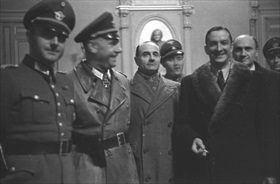 Vichy police chief René Bousquet (right) with Germans, January 23, 1943