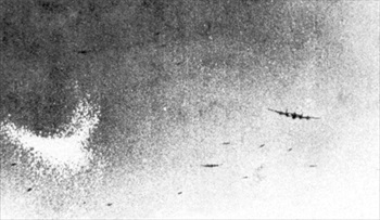 RAF Avro Lancaster dropping chaff over Germany
