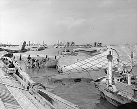 Destroyed Mulberry Harbor, Omaha Beach, late June 1944