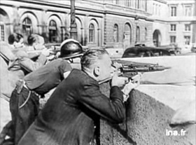 Liberation of Paris: Parisian snipers at street barricade, August 1944