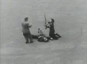 Parisians disarm dead German soldier, August 1944