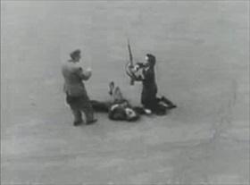 Parisians disarm dead German soldier, August 1944