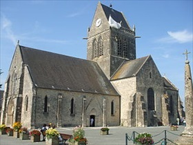 Normandy's Sainte-Mère-Église church with parachute memorial