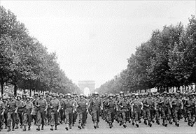 U.S. troops march down the Champs Élysées, Paris, August 29, 1944