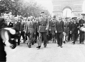 De Gaulle and entourage walk down the Champs Élysées, Paris, August 25, 1944