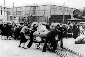 Battle of France: Fleeing civilians at rail yard with belongings, June 1940