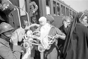 Battle of France: Baby and stroller put aboard train, June 1940