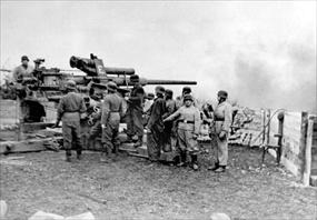 Battle of Seelow Heights: A German artillery gun fires on Soviet positions, April 1945