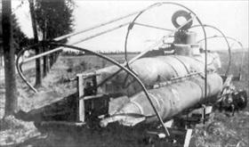Damaged Biber on transportation trailer, 1945
