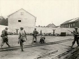 U.S. soldiers execute SS prisoners in Dachau's coal yard, April 29, 1945