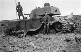 German soldiers with destroyed Soviet tank near Kaunas, Lithuania, June 1941