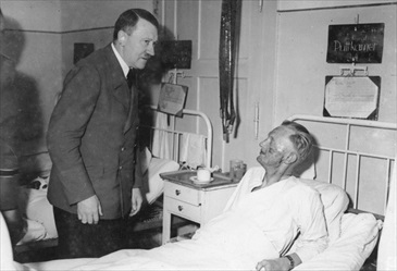 Hitler making a hospital call to injured