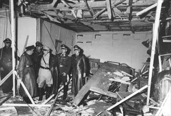 Hermann Goering (in khaki) showing visitors scene of destruction