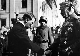 Adolf Hitler greets President Hindenburg as new Reichstag convenes, March 1933