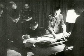 Chamberlain signs off on the Munich Agreement, early September 30, 1938