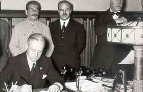 Ribbentrop signs 1939 pact overseen by Stalin and Molotov
