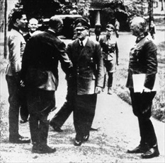 Claus von Stauffenberg (left) with Hitler, July 15, 1944