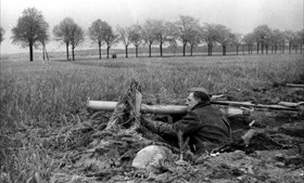Volkssturm recruit preparing to fire weapon on the outskirts of Berlin, 1945