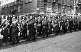 Arrow Cross militiamen march in Buda's Castle district, October 1944