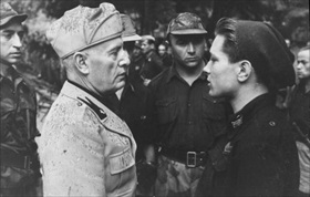 Axis Pact of Steel: Mussolini with Blackshirt teenager, 1944