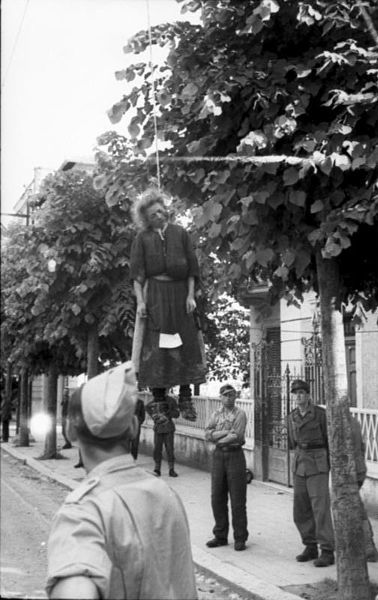 Italian resistance movement: A young woman executed by public hanging in a street in Rome, early 1944