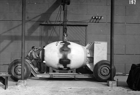 "Nagasaki atomic bomb: ""Fat Man"" being placed on transport dolly, probably August 8, 1945"