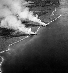 Japanese transports beached and burning, Guadalcanal, November 1942