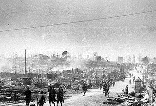 Residents walk through rubble-strewn Tokyo following March 9, 1945, firebombing