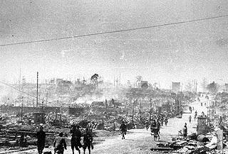 Firebombing Tokyo: Residents walk through rubble-strewn Tokyo following March 9, 1945, firebombing