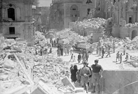 Bomb-damaged street, Malta, April 1942