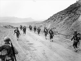 U.S. II Corps passes through Kasserine Pass, late February 1943 B