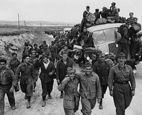 Italian POWs being escorted out of Tunis, May 7, 1943