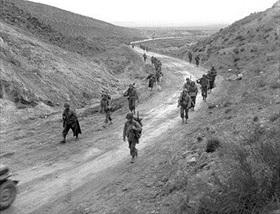 U.S. II Corps passes through Kasserine Pass, late February 1943 A