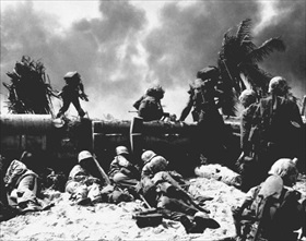Operation Cartwheel and Battle of Tarawa: Marines climb over coconut-log barricade at beachhead, late November 1943