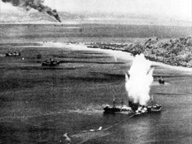 Operation Hailstone: Japanese freighter torpedoed