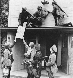 German troops remove Polish insignia, 1939