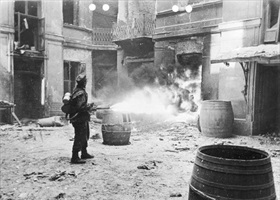 Warsaw Uprising: Routing insurgents using flamethrower, Warsaw 1944